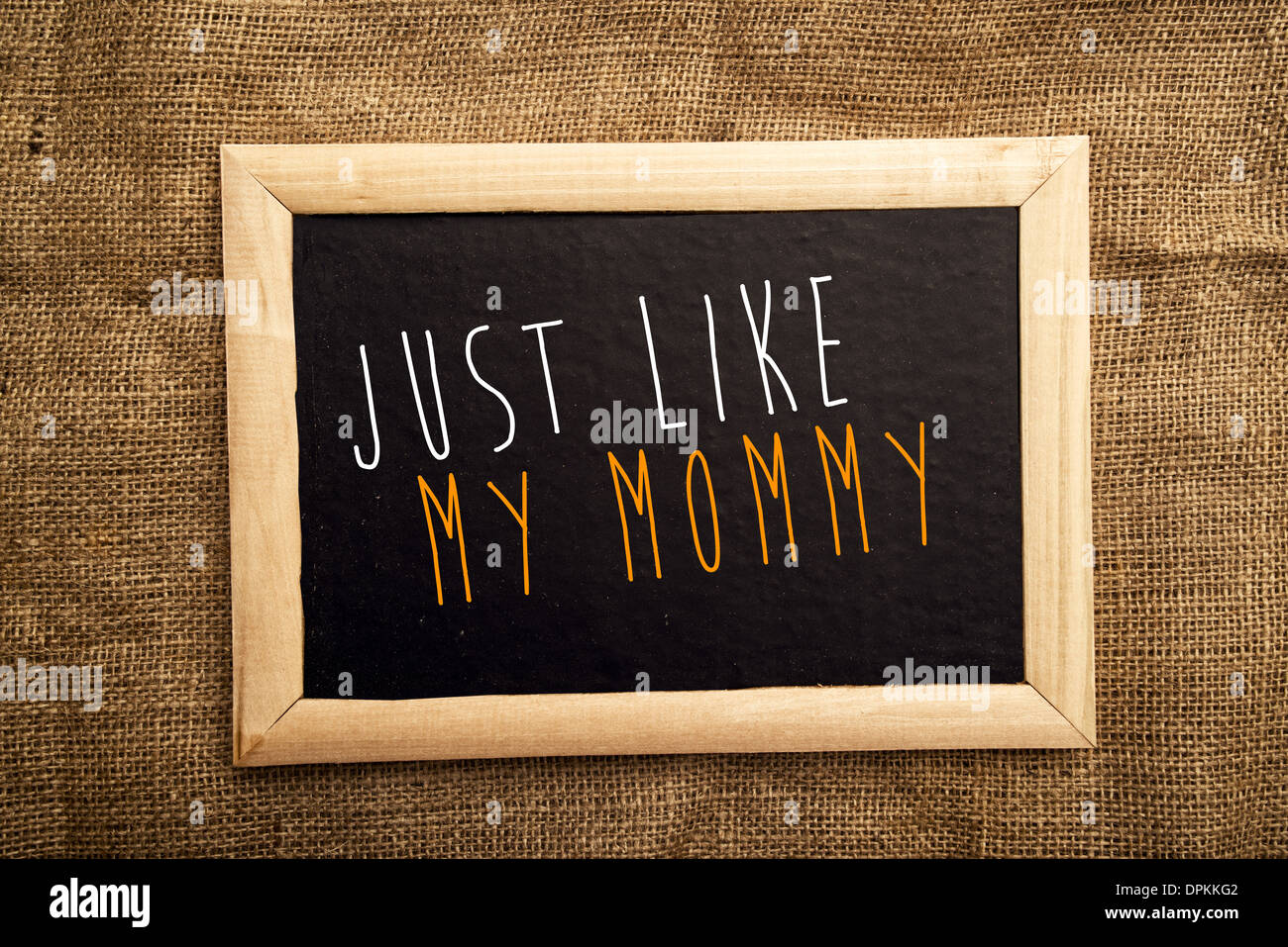 Just like my mommy note on black message board - Stock Image