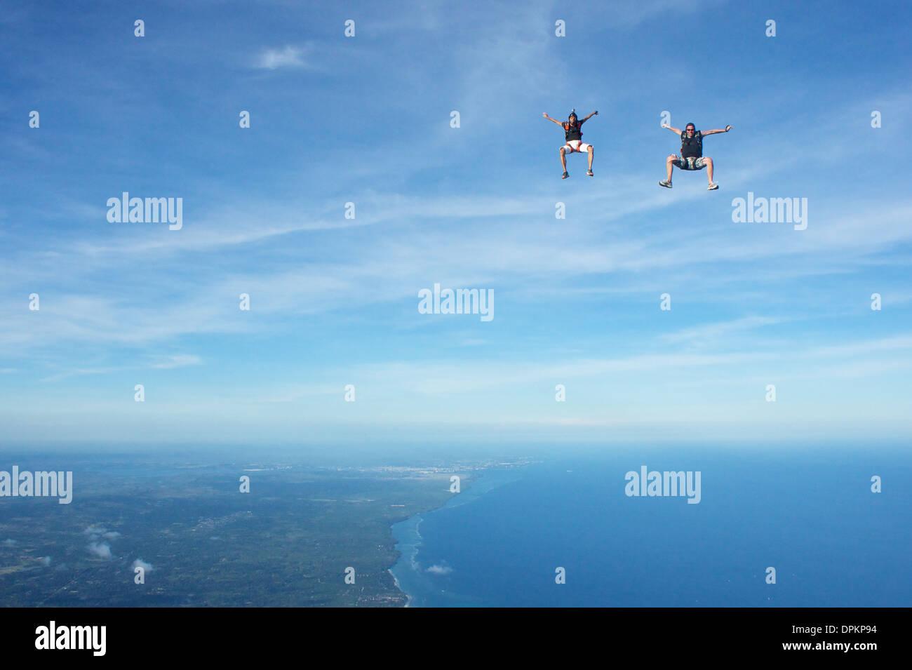 Skydivers freeflying over Diani Beach, Kenya - Stock Image