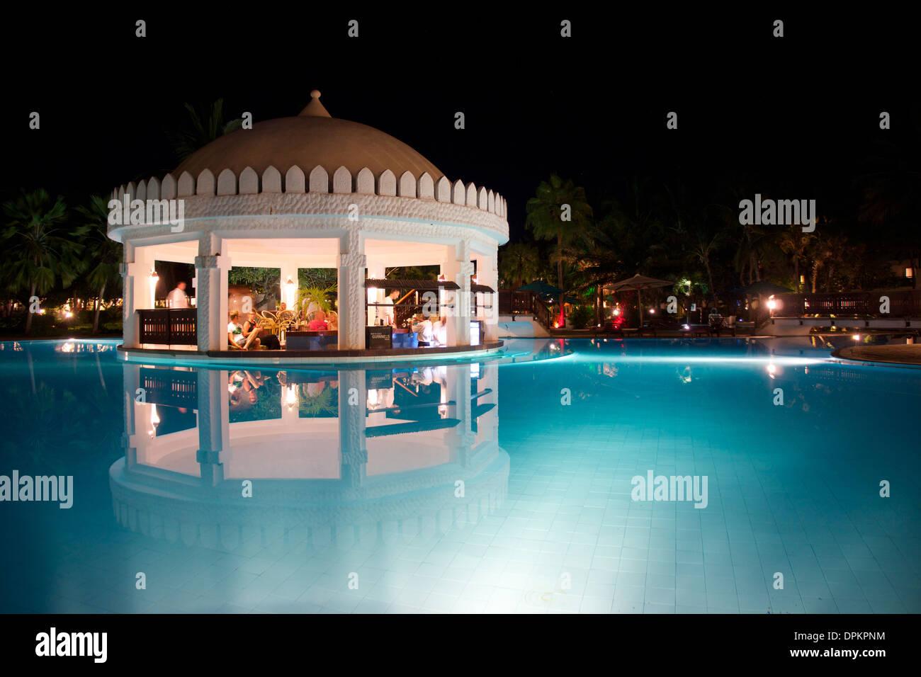 Swim up bar at night, Southern Palms Resort, Diani Beach, Kenya - Stock Image