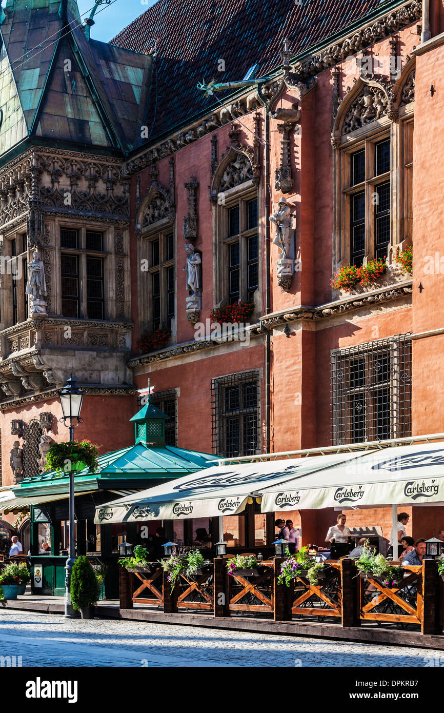 Outdoor Restaurant Bar Beneath The Neo Gothic Town Hall Or Ratusz In Stock Photo Alamy