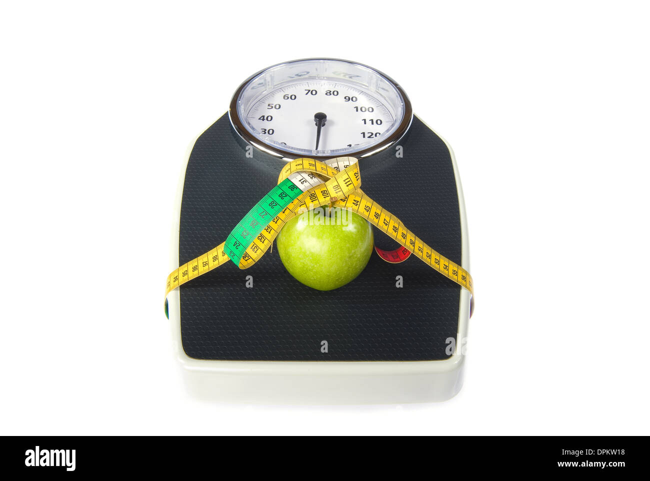 A weight scale with measuring tape and an apple - Stock Image
