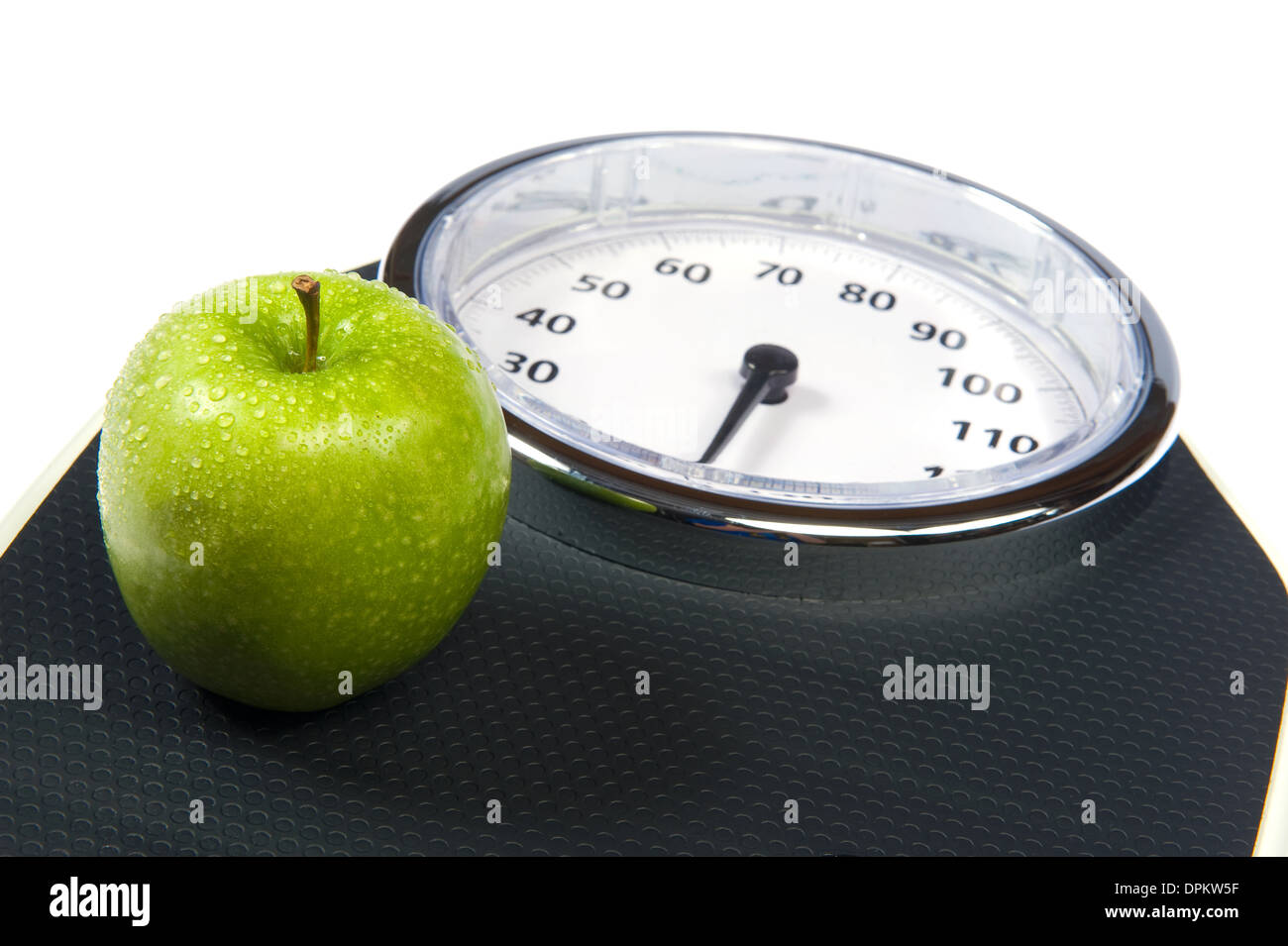 A weight scale with an apple - Stock Image