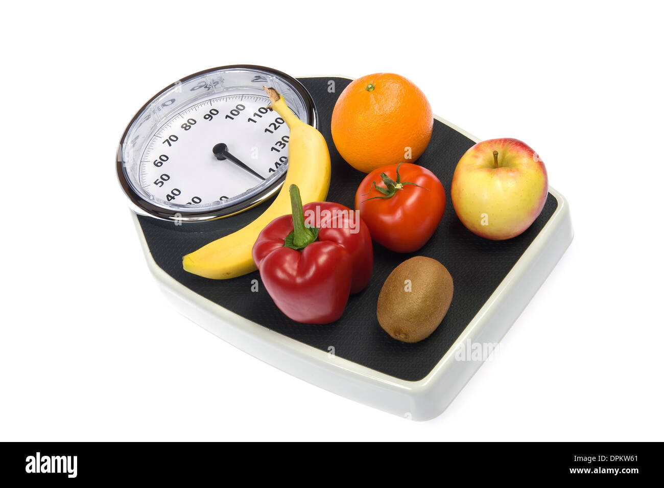 A weight scale with fruit - Stock Image