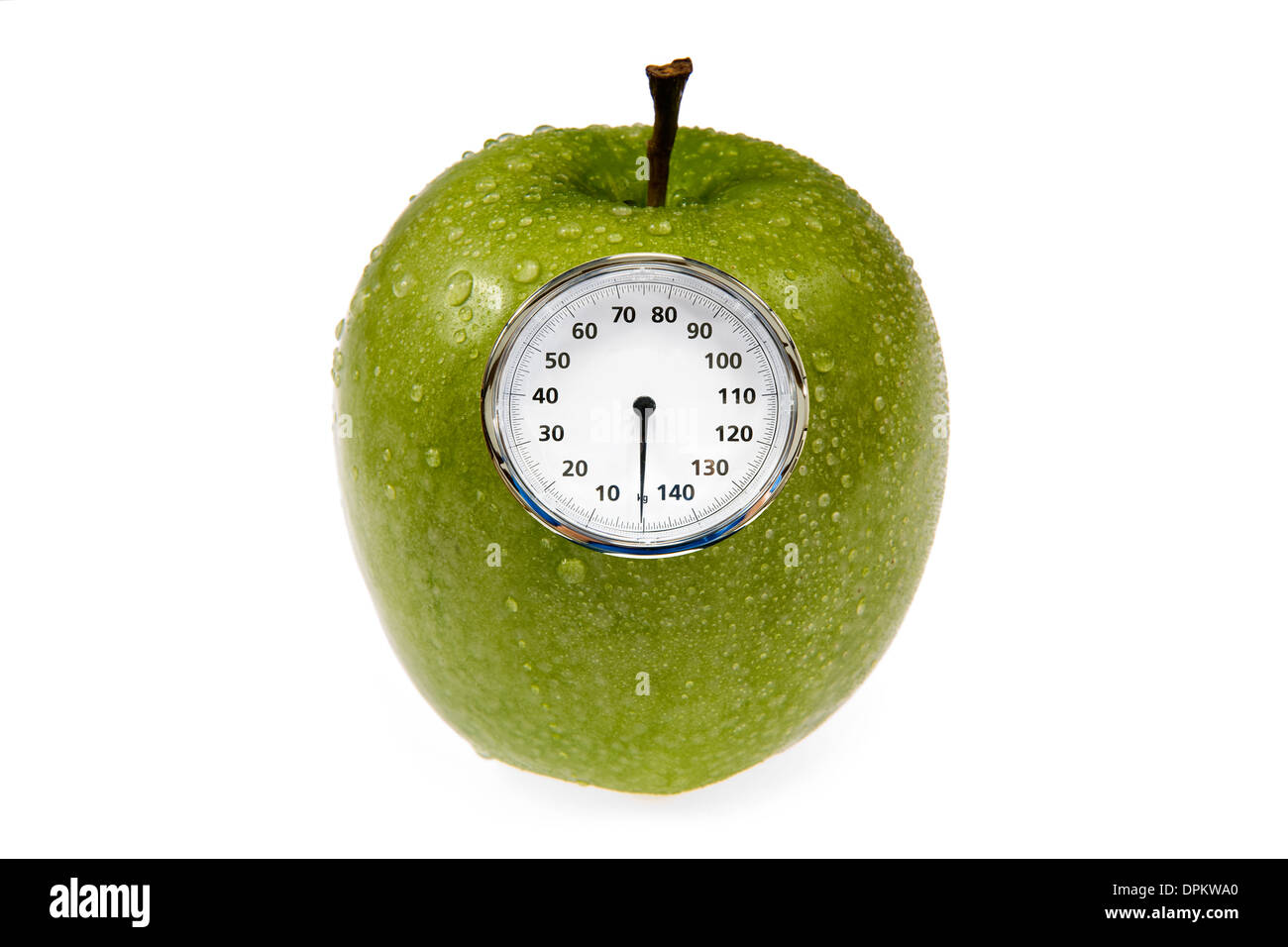 An apple with a weight scale on it - Stock Image