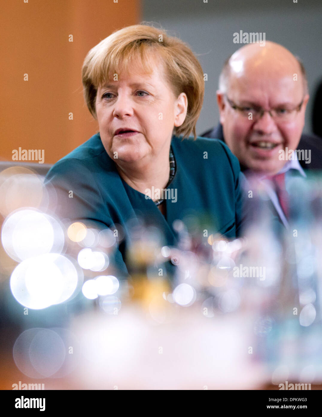 Berlin, Germany. 15th Jan, 2014. German Chancellor Angela Merkel (CDU) sits next to Chief of Staff of the German Stock Photo