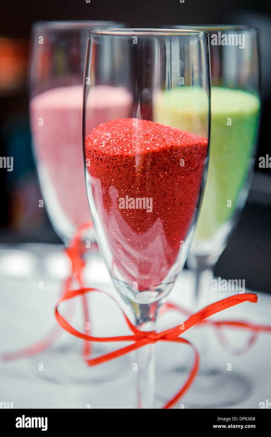 Champagne glasses with red bows decor - Stock Image