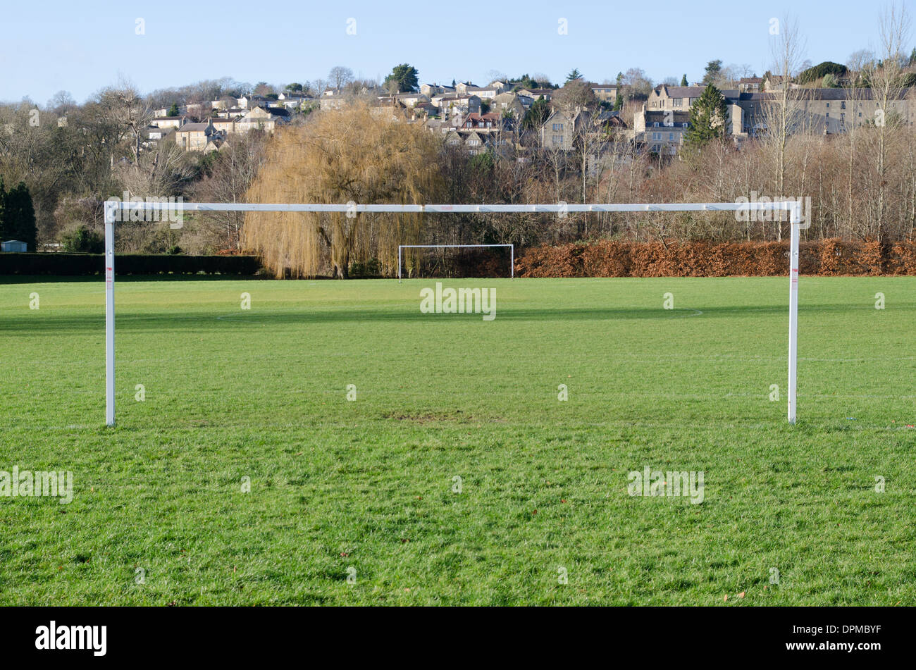 A British park football pitch goal posts - Stock Image
