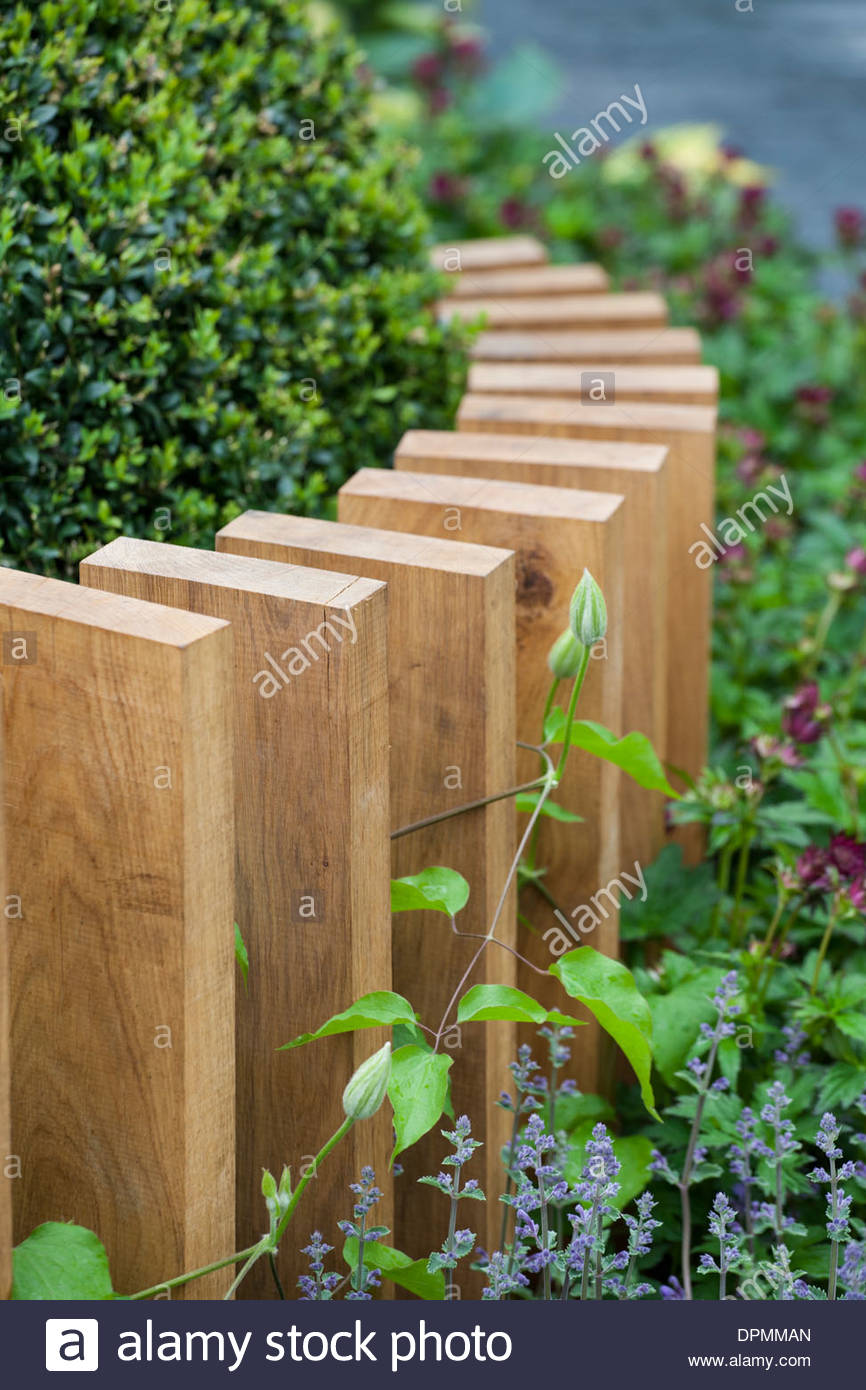 Chelsea Flower Show, 2013. The SeeAbility Garden. Wooden plank garden fence - Stock Image