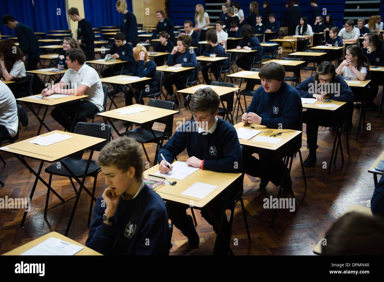 Welsh teenage GCSE school pupils sitting exams in a school hall, Wales UK - Stock Image