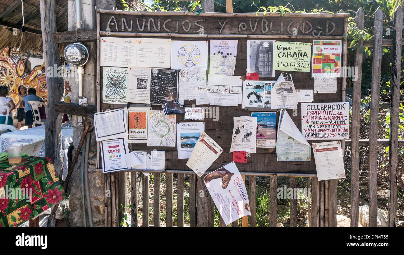 announcements on public bulletin board in Zipolite give an idea of Christmas activities in town & neighboring San Agustinillo - Stock Image