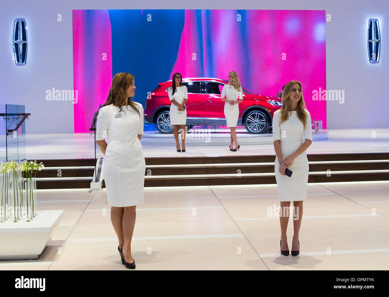 Detroit, Michigan - Models working at the Lincoln display at the North American International Auto Show. - Stock Image