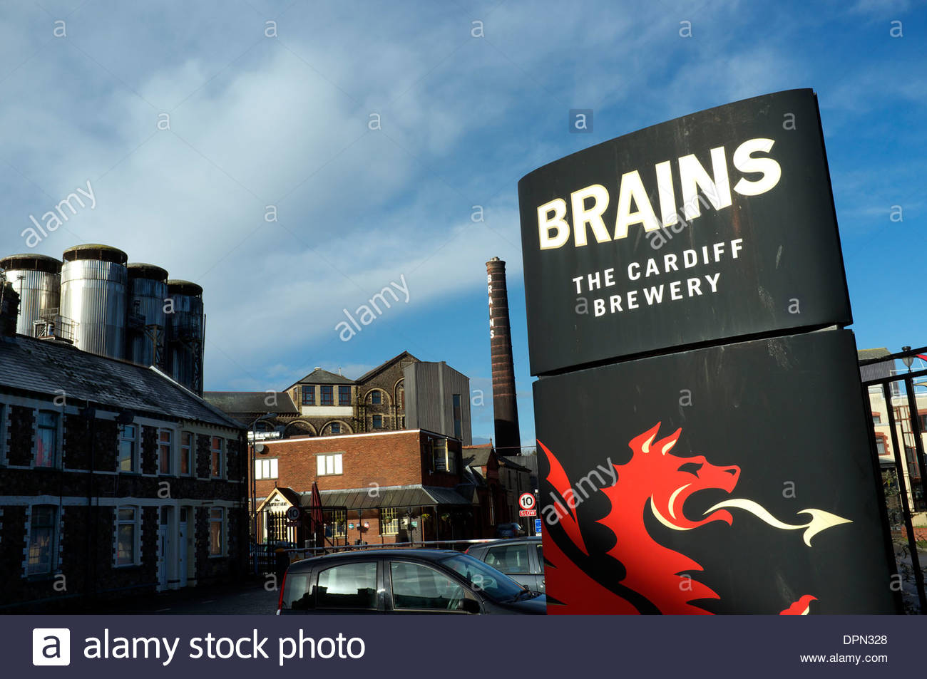 Brains, the factory premises of the Cardiff brewery, with the sign written chimney stack visible in the background. Cardiff, UK. - Stock Image