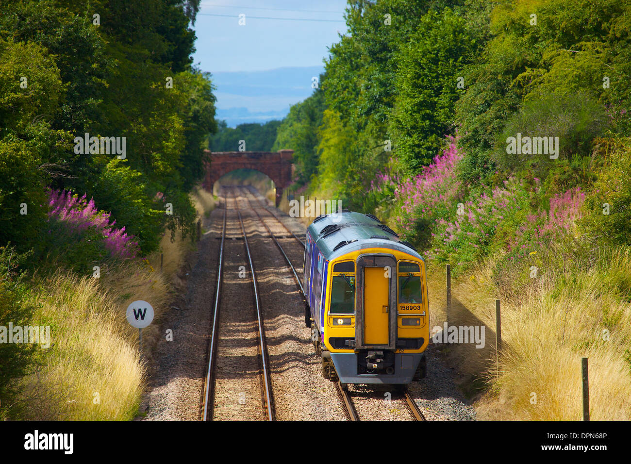 Passenger train at Wetheral Sheild on the Settle to Carlisle Railway Line in Cumbria England United Kingdom - Stock Image