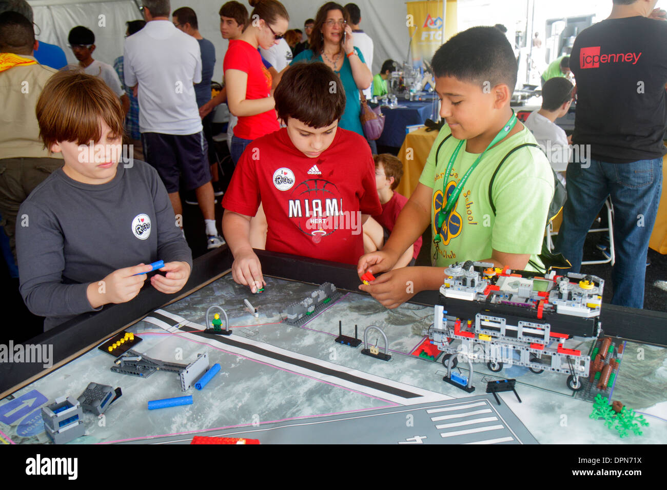 Miami Homestead Florida Speedway DARPA Robotics Challenge Trials robot robots exhibits student boy Hispanic Lego Stock Photo