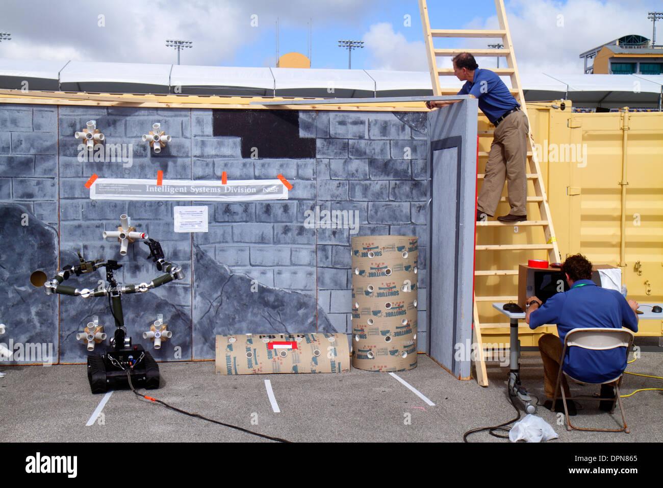 Miami Homestead Florida Speedway DARPA Robotics Challenge Trials remote controlled robot robots disaster response test - Stock Image