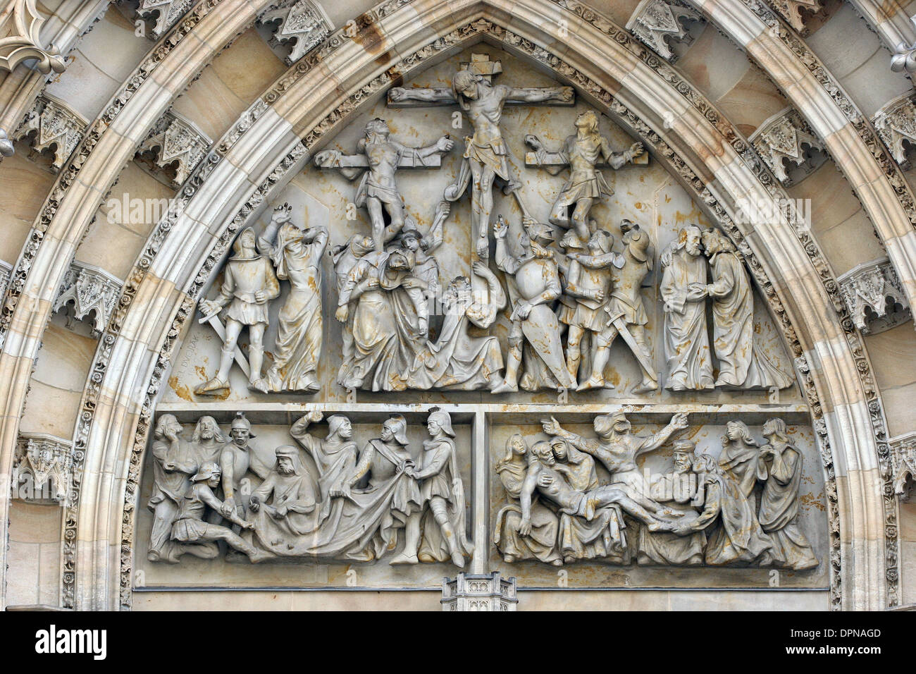 Czech Republic. Prague. St. Vitus Cathedral. Archivolts and tympanum. Gothic Revival. West facade. 19th century. Castle complex. - Stock Image