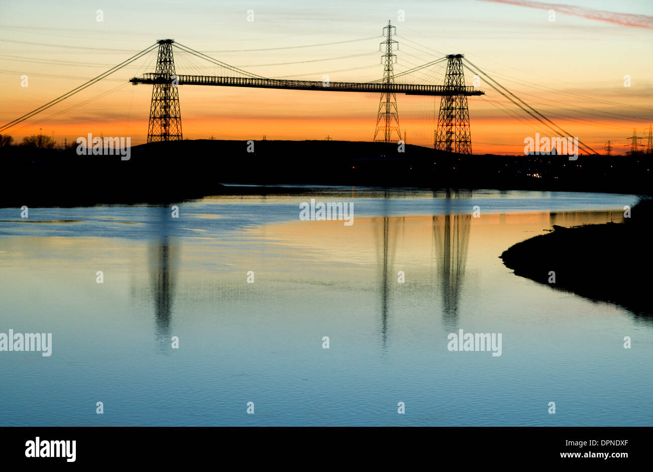 Newport Transporter Bridge at sunset, built in 1906 and spanning the River Usk , Newport, Gwent, South Wales. - Stock Image