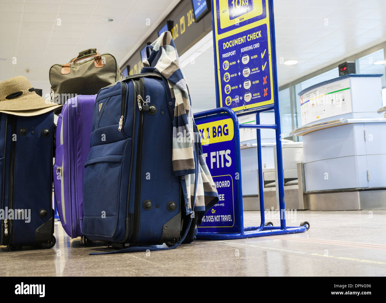 Luggage at Ryanair check in - Stock Image