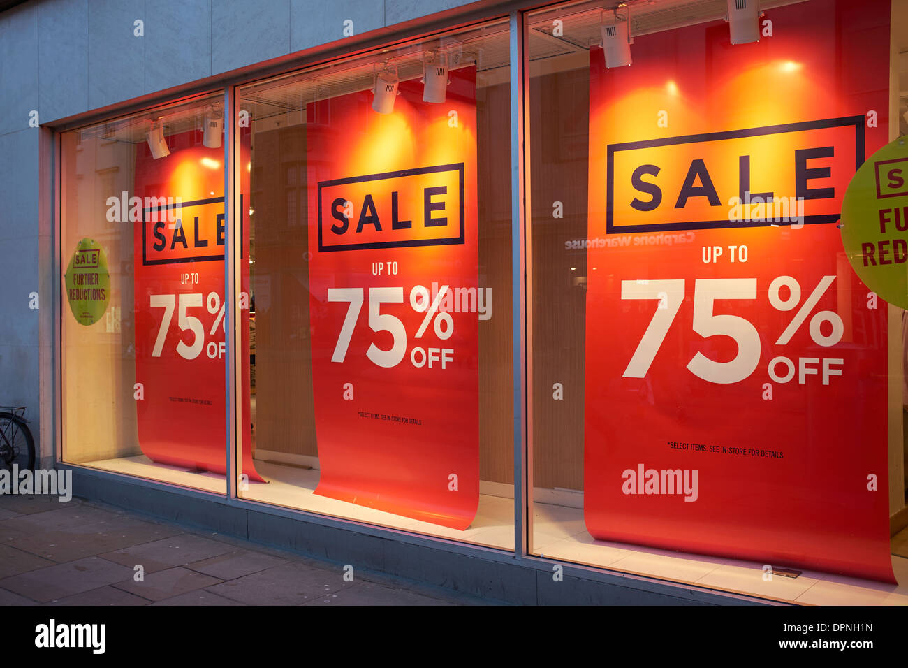 Sale up to 75% off banners in a shop window - Stock Image