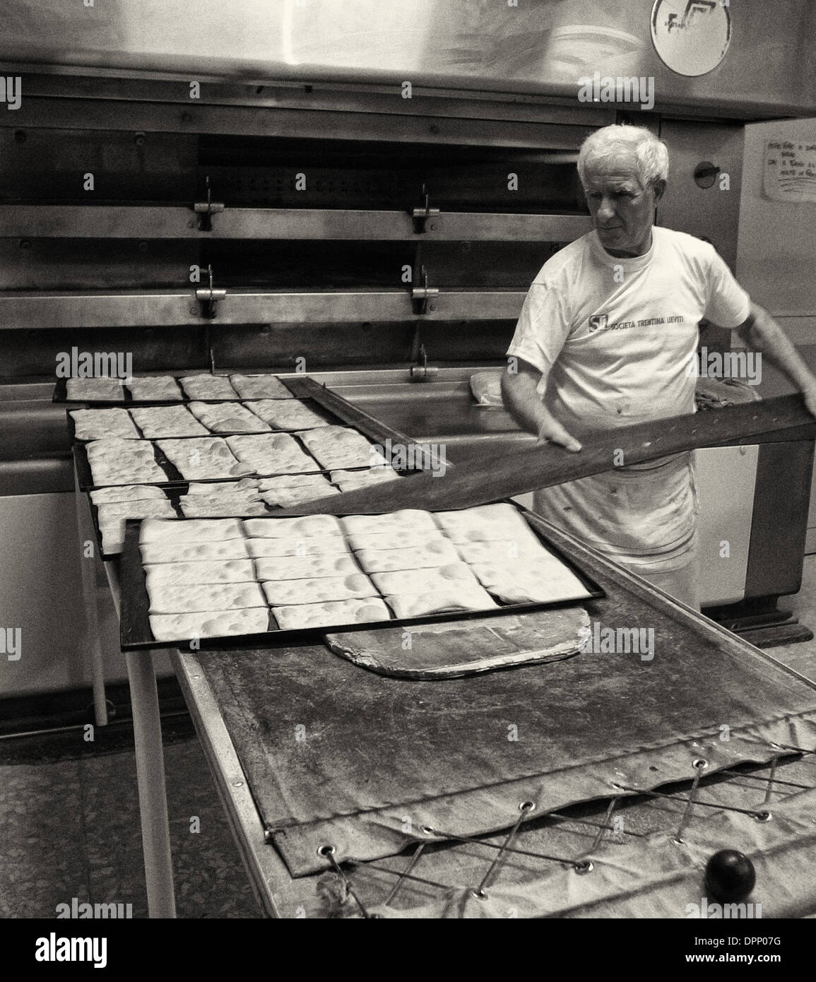 Focaccia being made in Ferrara bakery - Stock Image