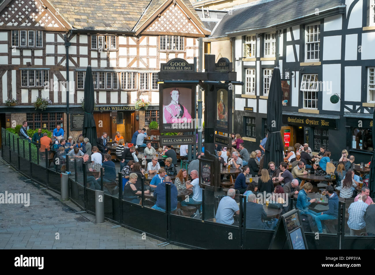 Eating and Drinking at the Wellington Inn and Sinclairs Oyster Bar Manchester City Centre. Stock Photo