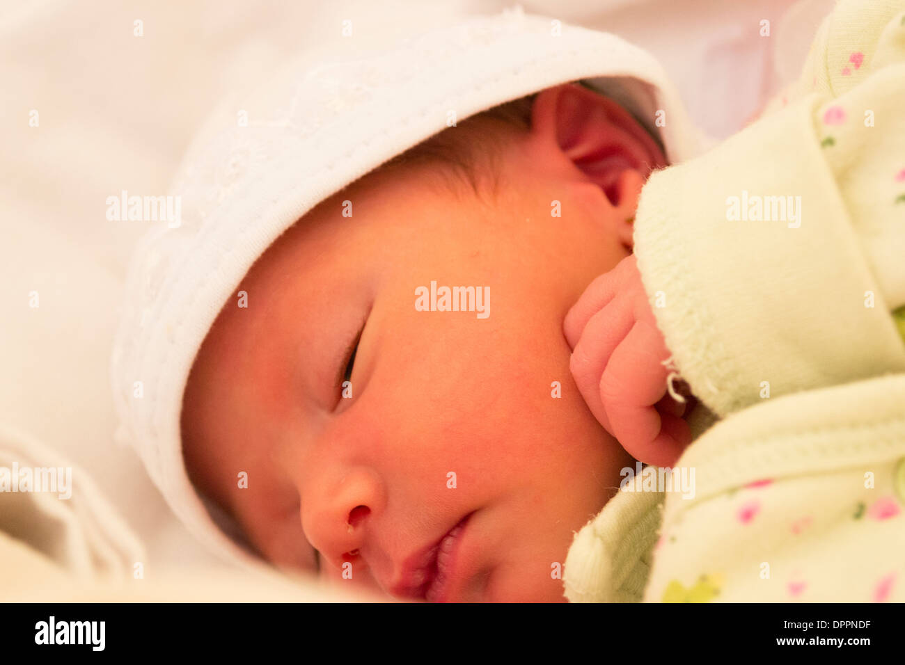 Baby girl sleeping, close-up on her face - Stock Image