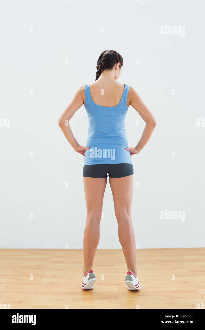 Rear view of a slim woman tip toeing - Stock Image