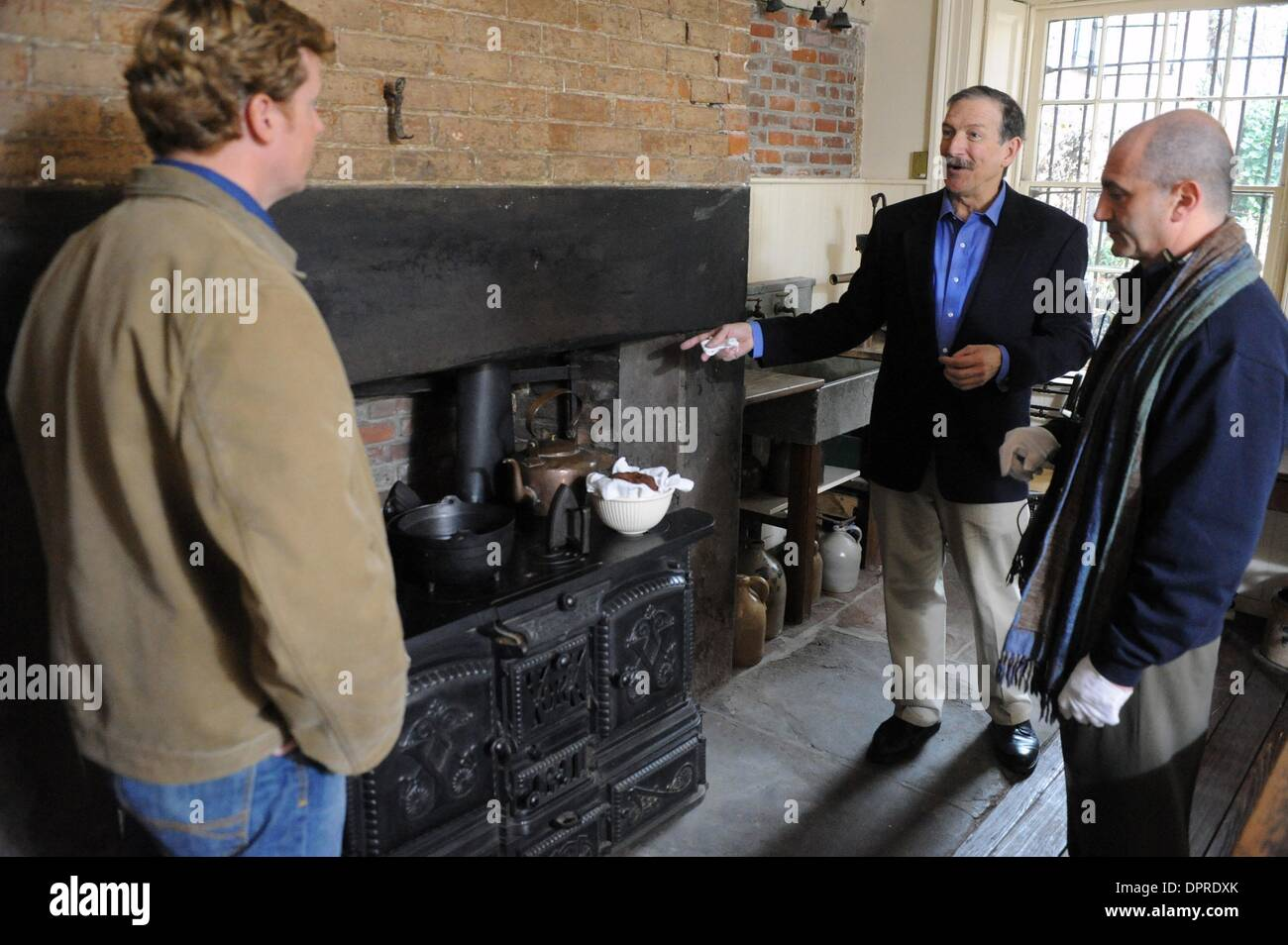 Dec 04, 2008 - Manhattan, New York, USA - KEVIN O'CONNOR (L), CHARLES LOCKWOOD (C) and director DAVID VOS (R) work on a scene. 'This Old House' taping with host Kevin O'Connor and special guest Charles Lockwood at the historic Merchant's House Museum in the East Village.  (Credit Image: © Bryan Smith/ZUMA Press) RESTRICTIONS:  * New York City Newspapers Rights OUT * - Stock Image