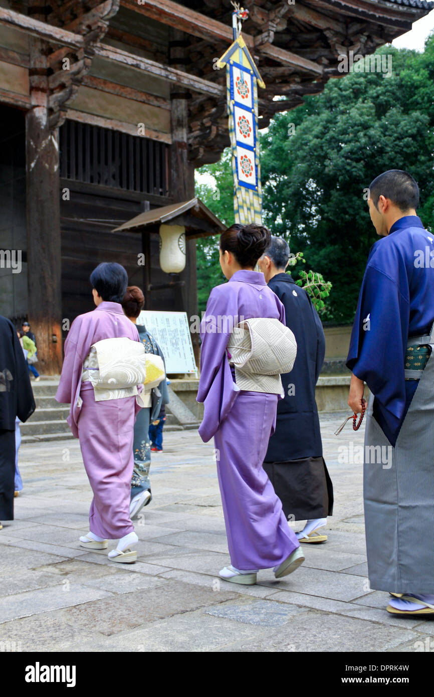 Japanese women wearing a traditional kimono and obi in a Buddhist procession at Todaiji Temple, Nara, Japan. - Stock Image