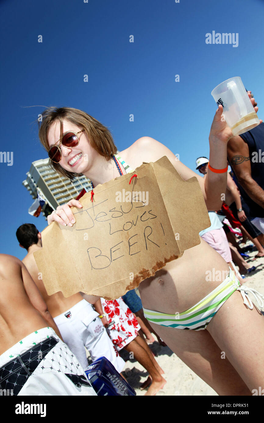 Mar 17, 2009 - Panama City Beach, Florida, USA - College Girl holds sign saying 'Jesus Loves Beer' during spring break 2009. (Credit Image: © Shane Babin/ZUMA Press) - Stock Image