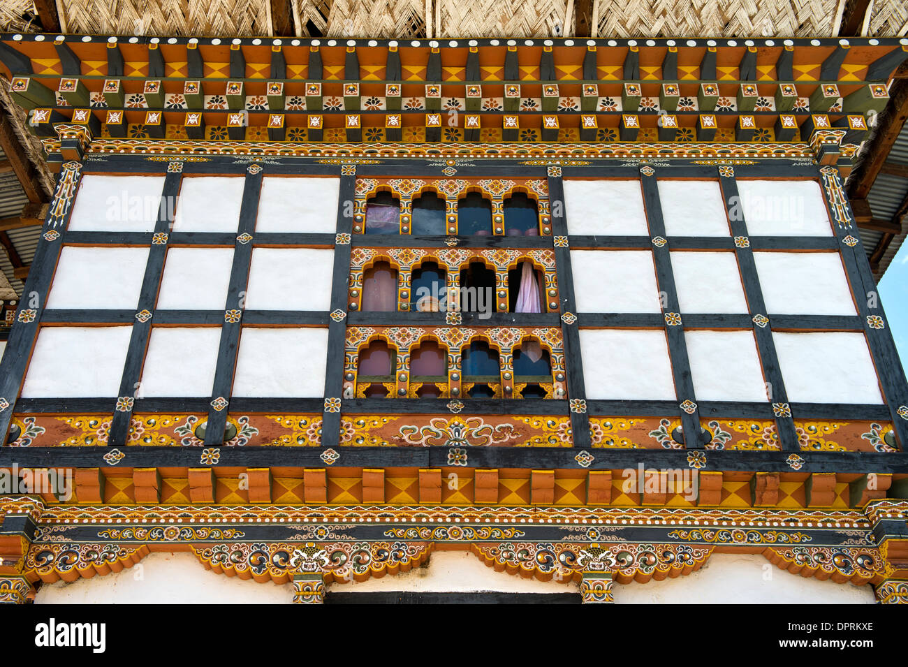 Colorful facade of a house in typical Bhutanese architectural style, Thimphu, Bhutan - Stock Image
