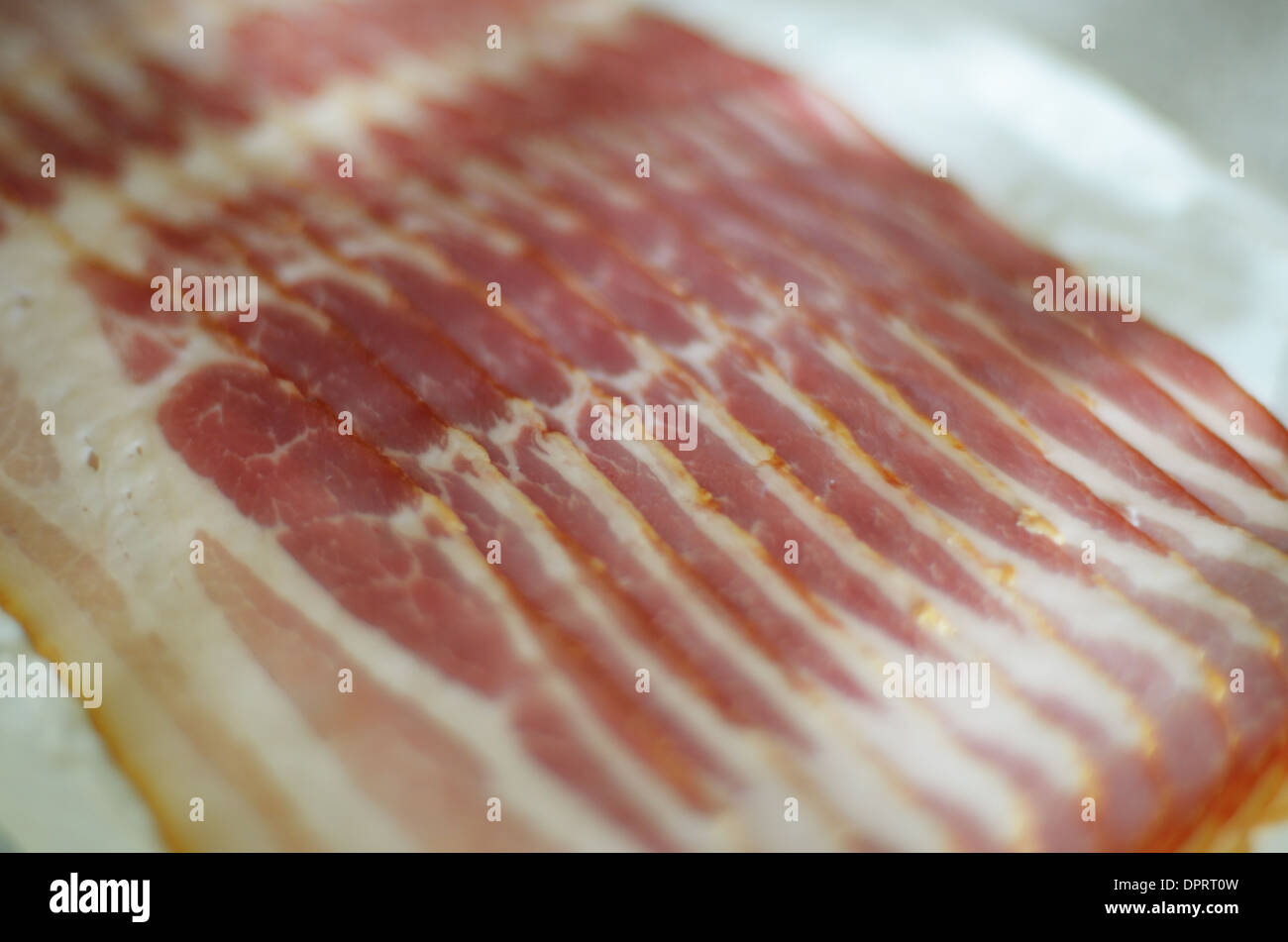 Bacon slices arranged on the table ready for catering - Stock Image