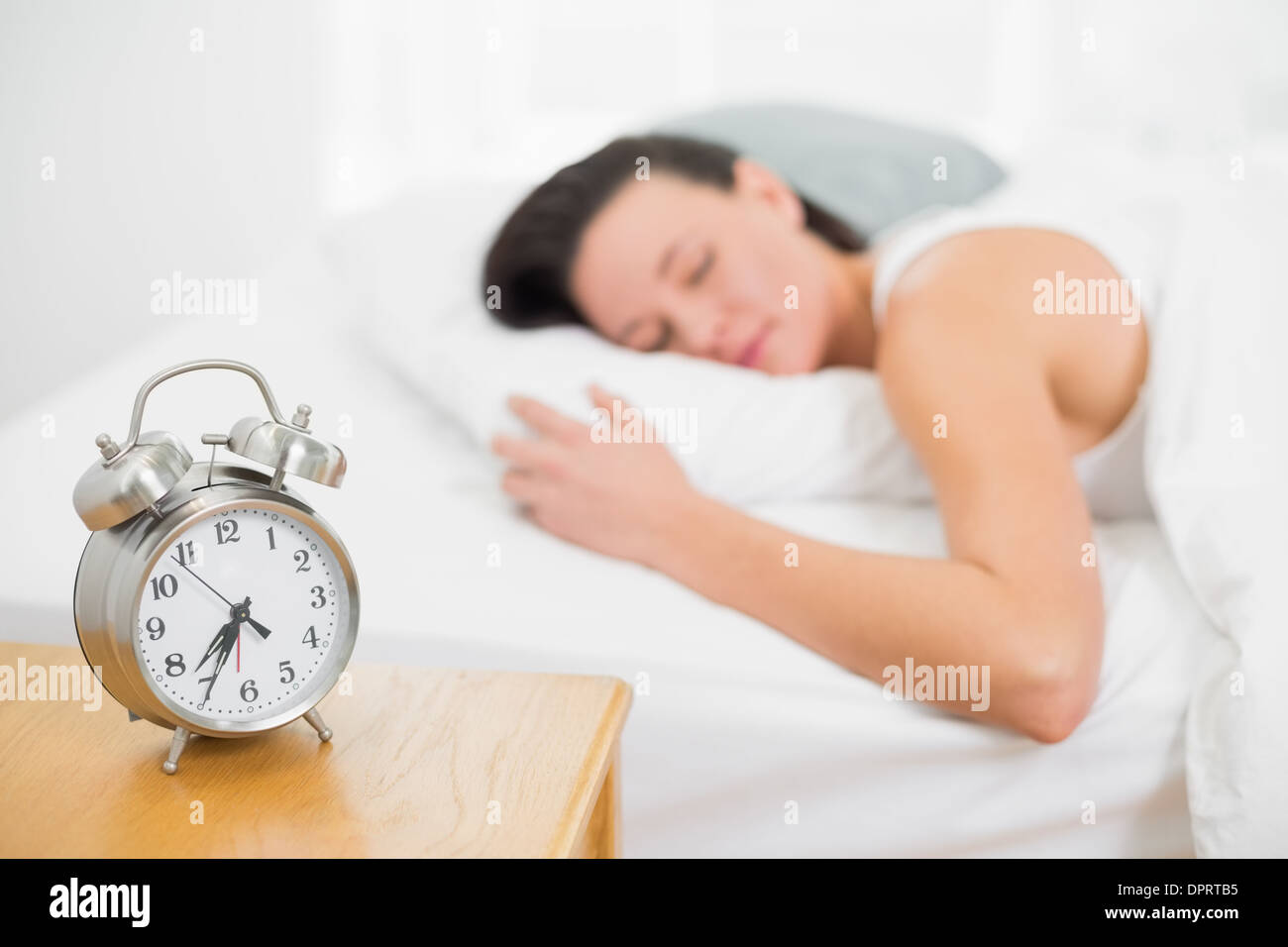 Best Alarm Bedside - blurred-woman-sleeping-in-bed-with-alarm-clock-on-bedside-table-DPRTB5  Image_488322.jpg