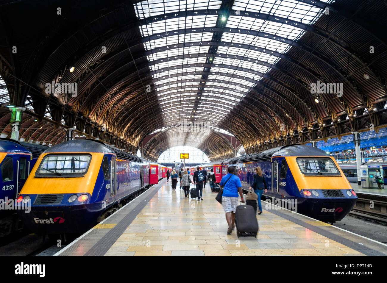 London Paddington Station with its grand curved roof and high speed trains - Stock Image
