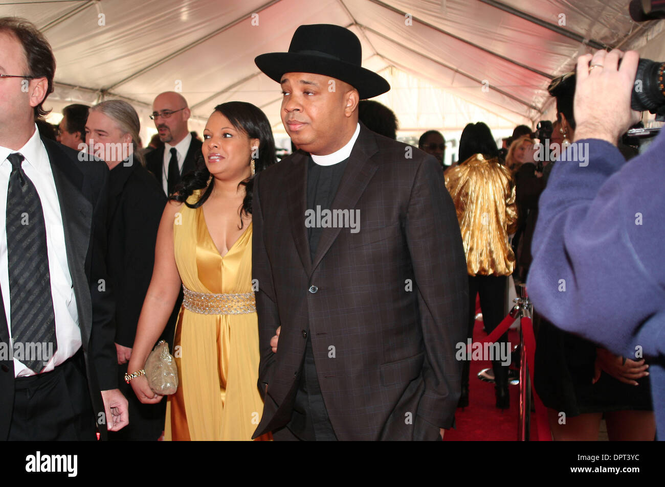 April 4, 2009 Cleveland, OH..Joseph ''Reverend Run'' Simmons of Run DMC, walked the red carpet with his wife, Justine Simmons at the Rock and Roll Hall of Fame induction ceremony at Cleveland's Public Hall Saturday, April 4, 2009...Jeff Moreland/CSMApril 04, 2009 Cleveland, OH....Jeff Moreland/CSM (Credit Image: © Jeff Moreland/Cal Sport Media) - Stock Image