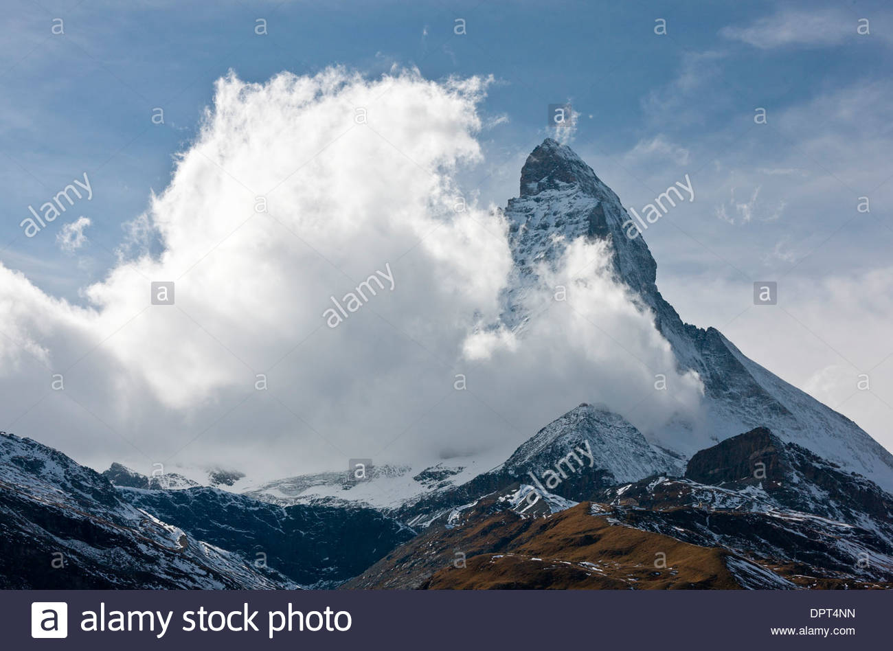 Matterhorn or Monte Cervino, with clouds coming up from the south; Switzerland. - Stock Image