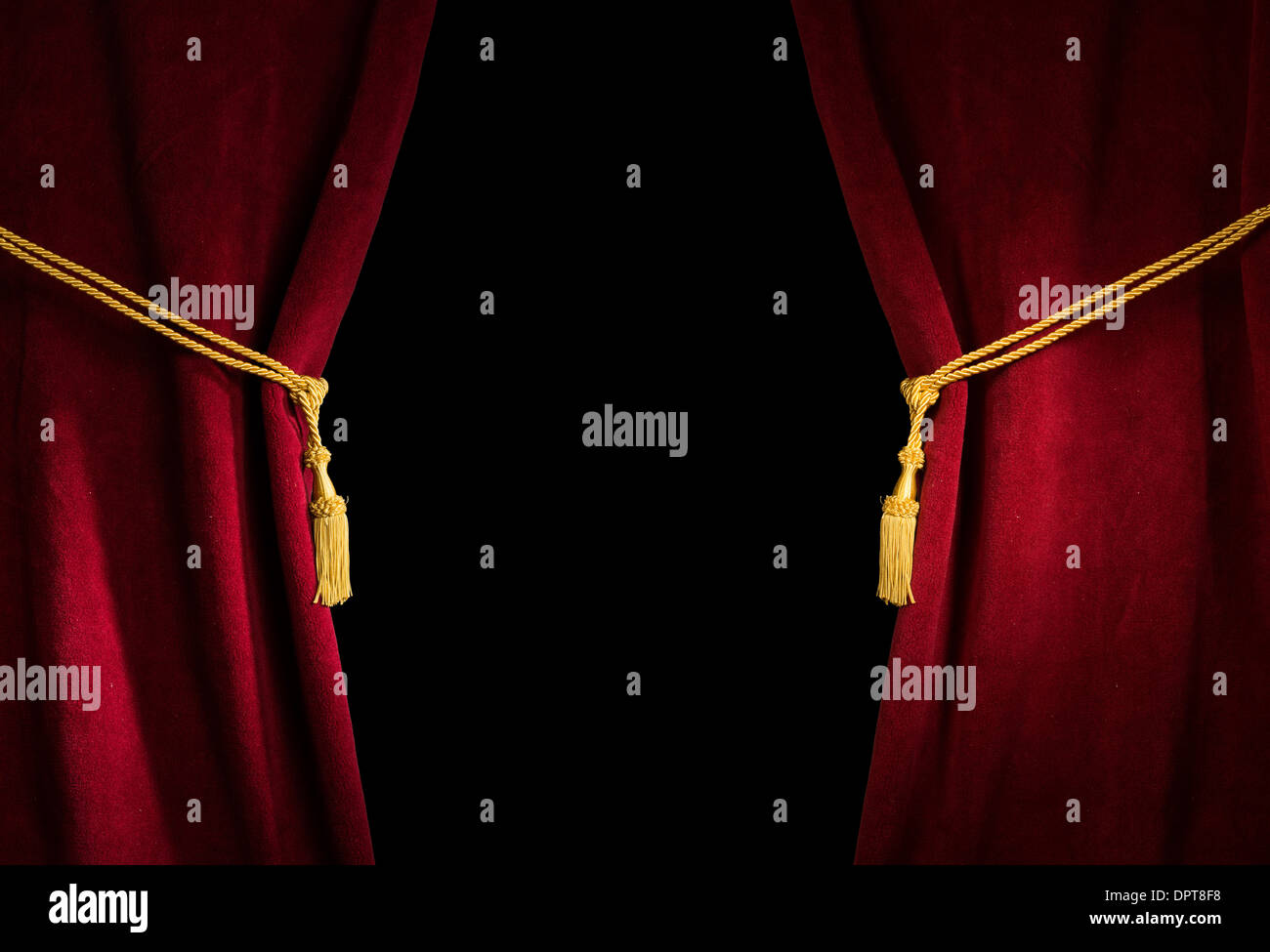 Red velvet curtain with tassel. Close up black isolated curtain - Stock Image