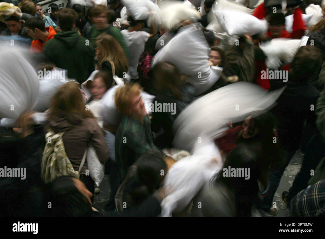 Apr 04, 2009 - New York, New York, USA - Revelers enjoy a massive pillow fight during the  International Pillow Fighting Day in Wall Street in Manhattan. People in over 25 cities around the world wield cushions for the massive battle as a celebration of public space.  (Credit Image: © Mehmet Demirci/ZUMA Press) - Stock Image