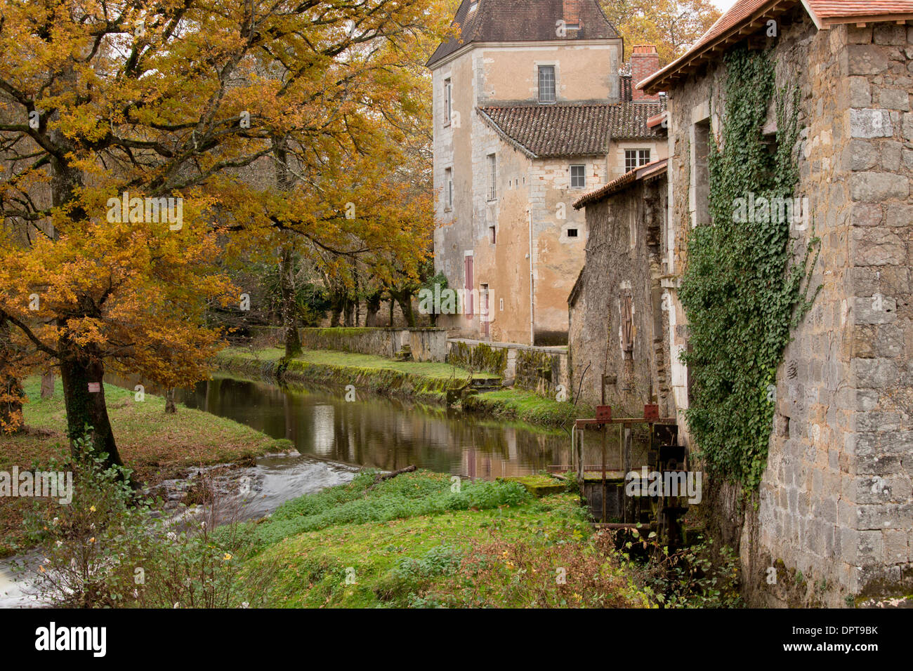 River and mill-race in the old village of St Jean de Cole, Dordogne, France. - Stock Image