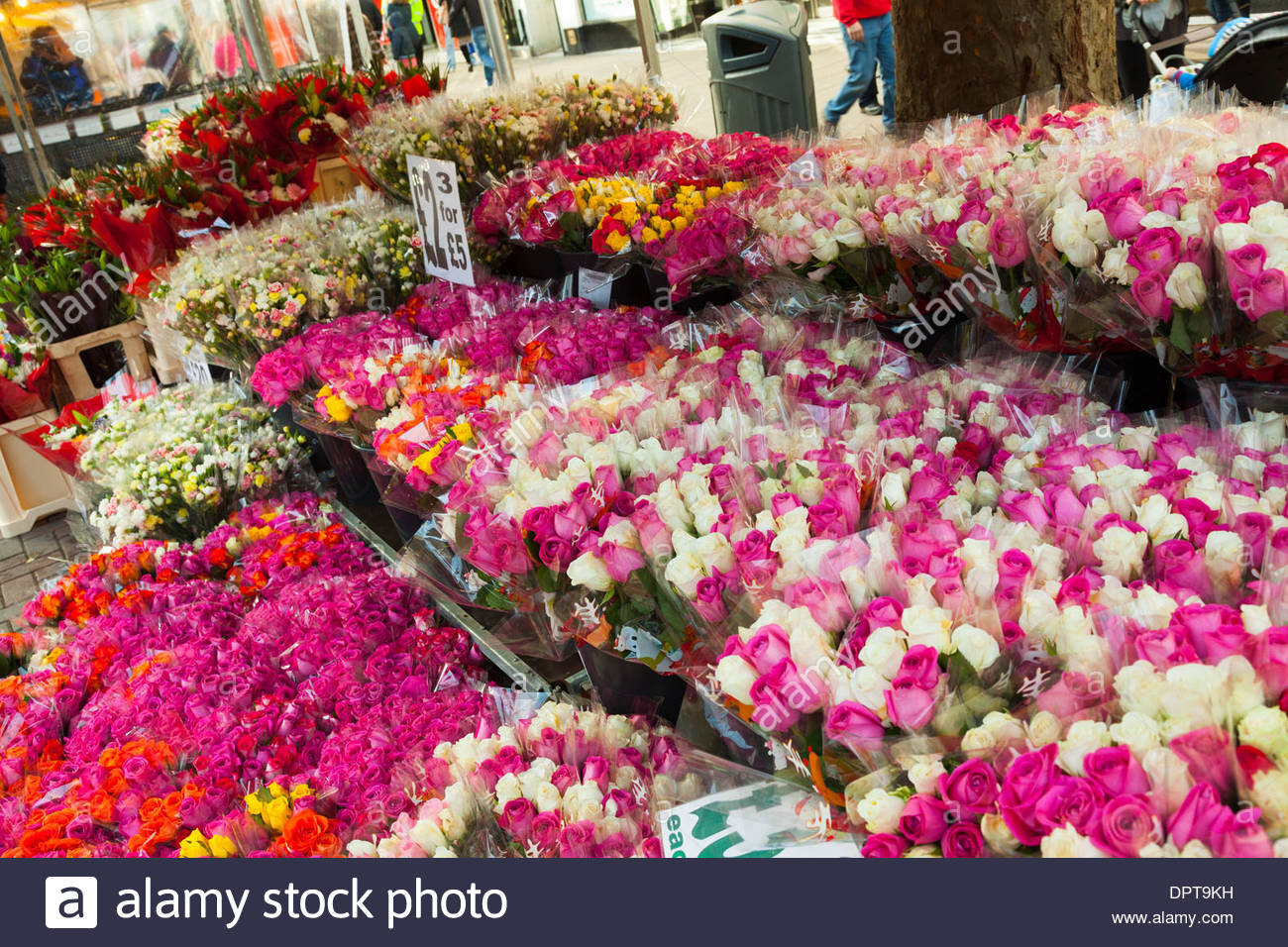 Colourful cut flowers market stall. - Stock Image