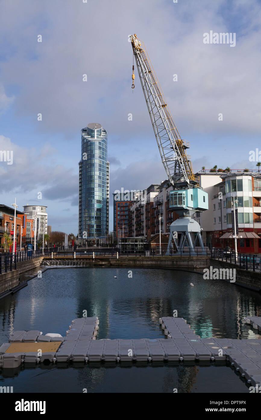 Gunwharf Quays with Dock Crane and No 1 Gunwharf Quays building. - Stock Image
