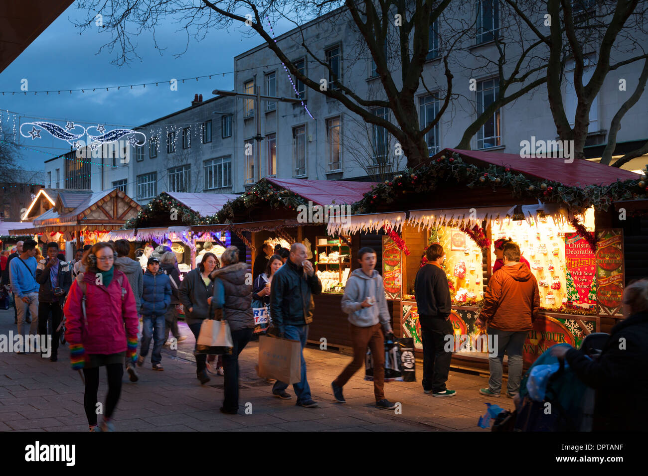 Shoppers at tradition christmas street market. - Stock Image