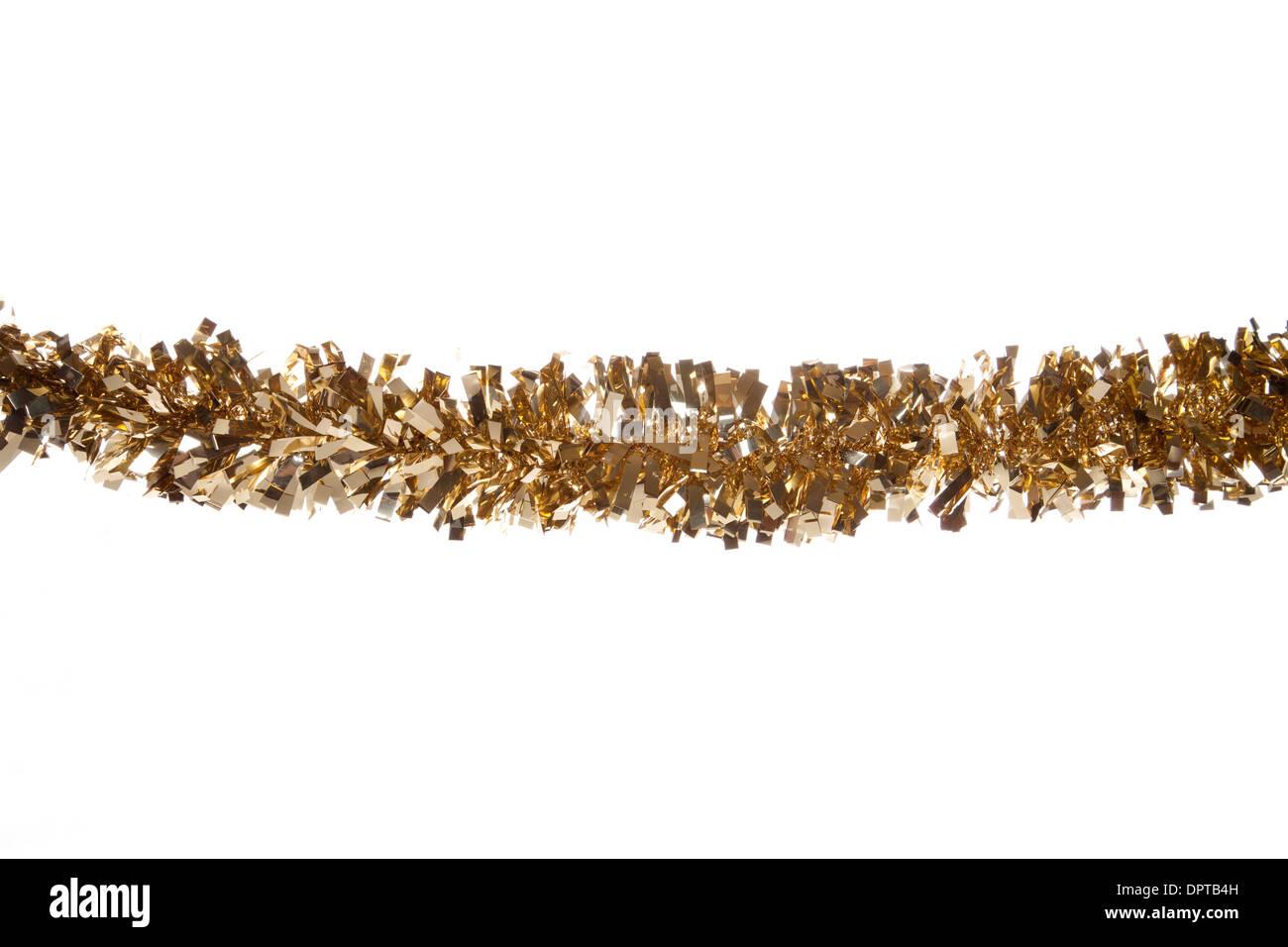 gold christmas tinsel border cutout - Stock Image