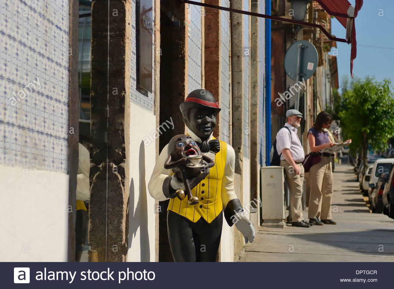 A caricature model of a black man advertising a coffee house, Braga, Douro Valley, Portugal - Stock Image