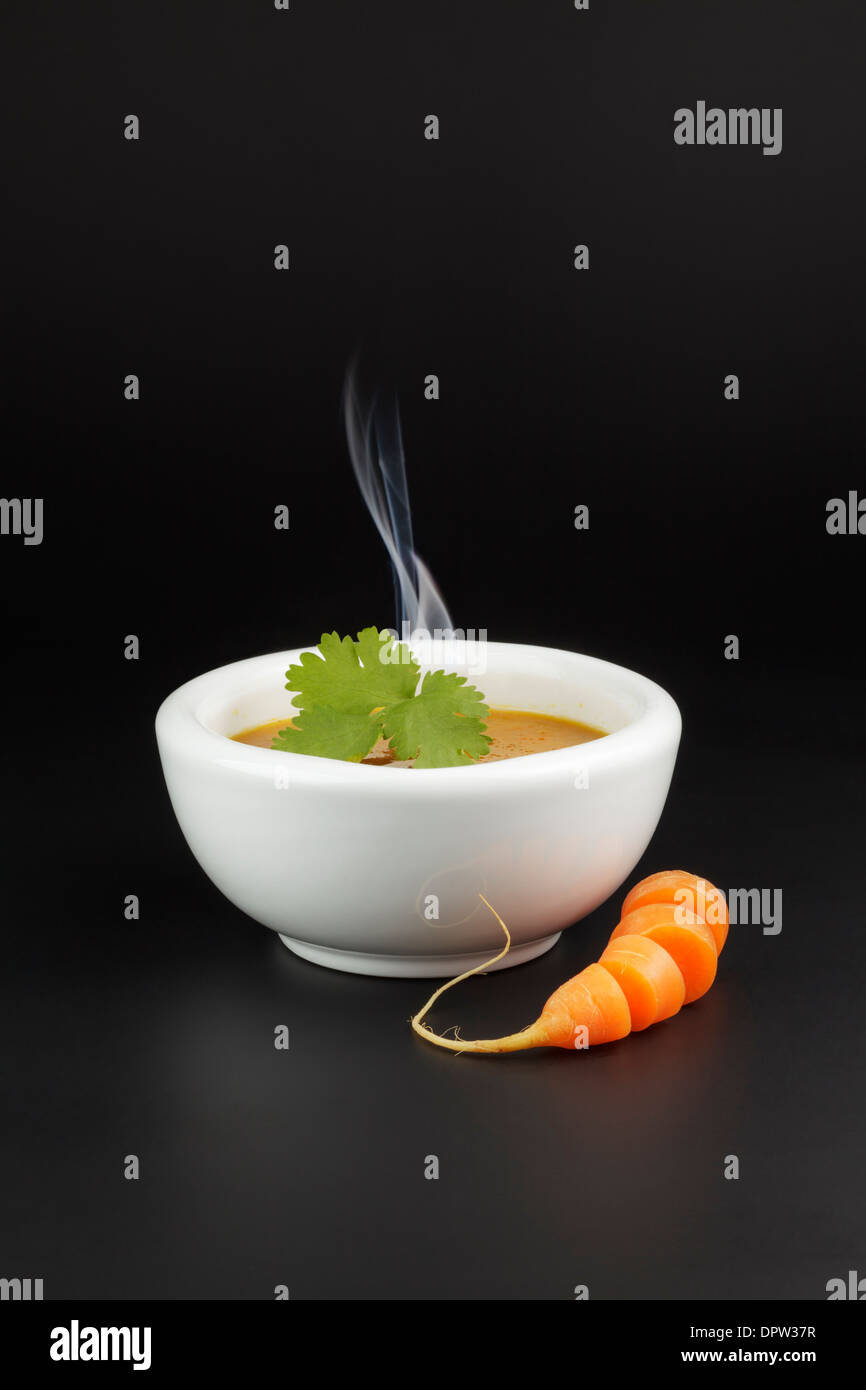 Carrot and coriander soup - Stock Image