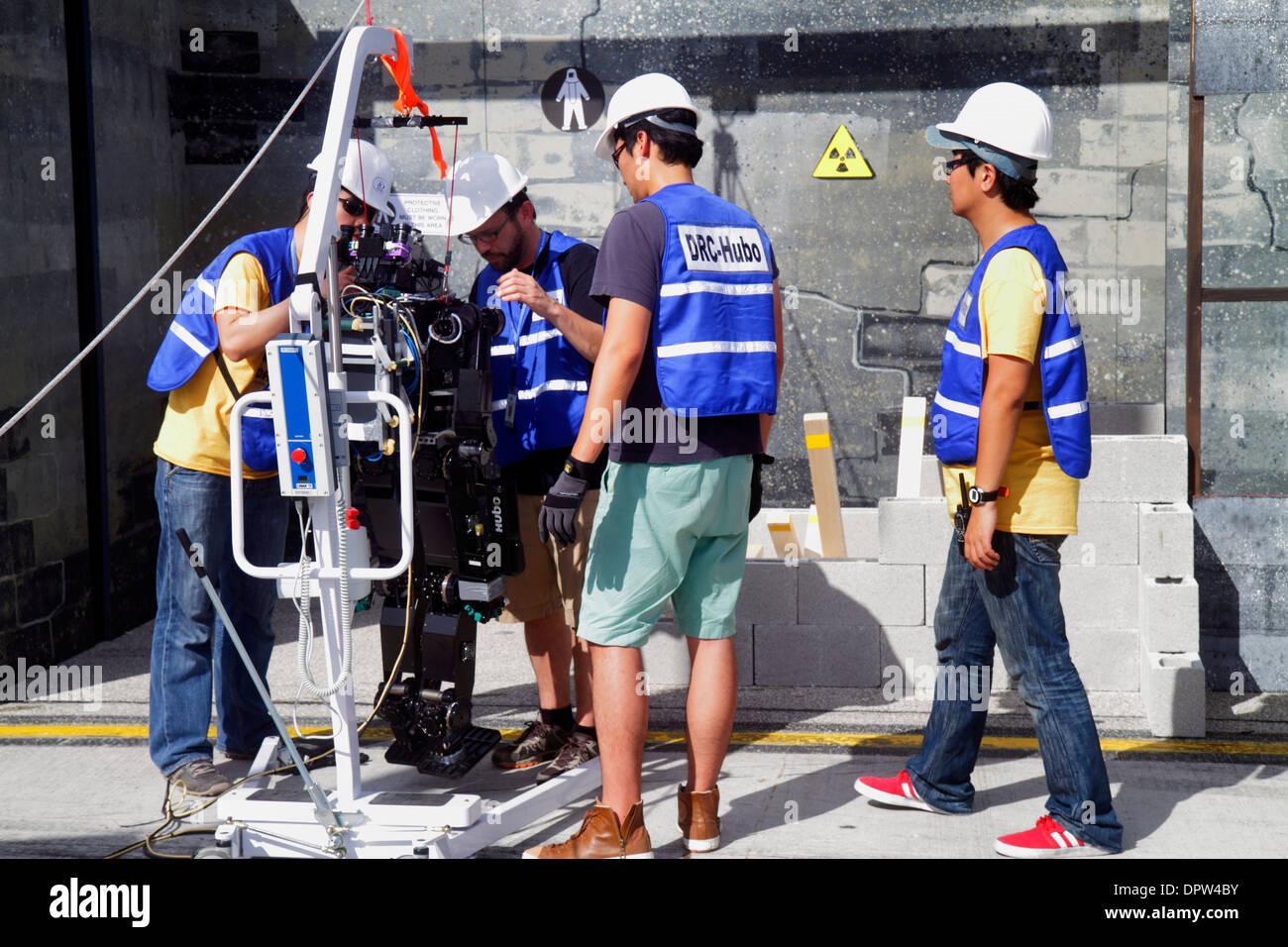 Miami Homestead Florida Speedway DARPA Robotics Challenge Trials remote controlled robot robots disaster response test engineer - Stock Image