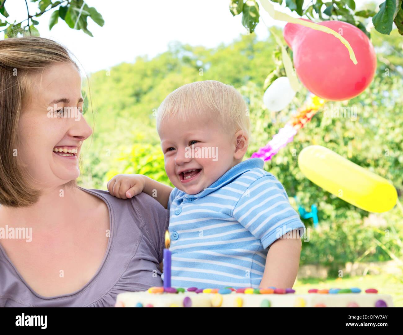 young family celebrates birthday - Stock Image
