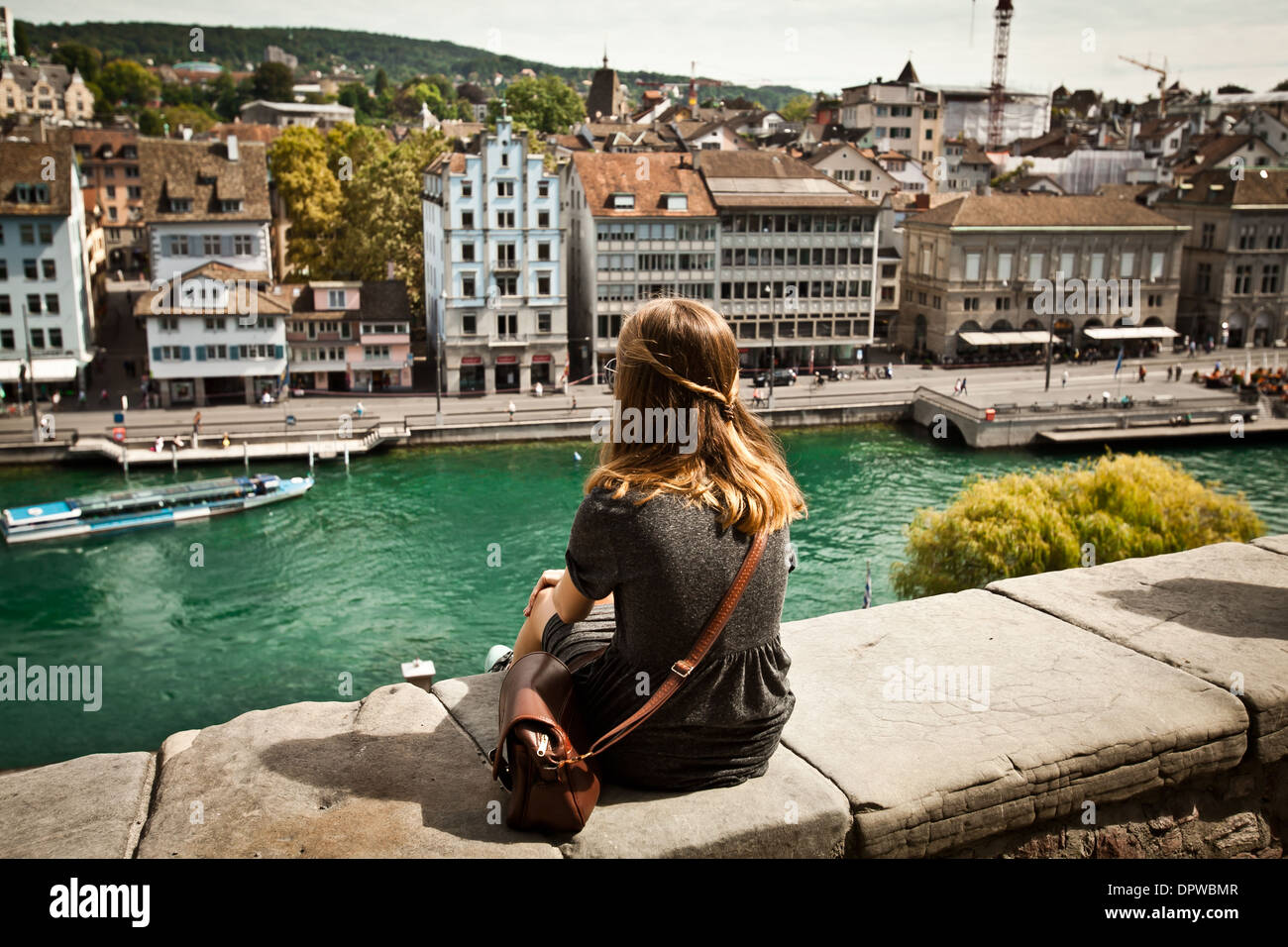 A young woman sightseeing beautiful view of Zurich, Switzerland - Stock Image