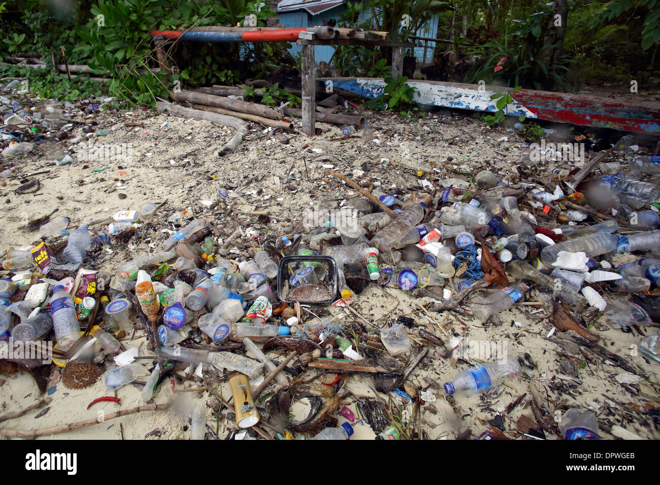 Plastic bottles, bags and other garbage pollute a south coast beach on Bunaken Island, a marine national park of Indonesia - Stock Image