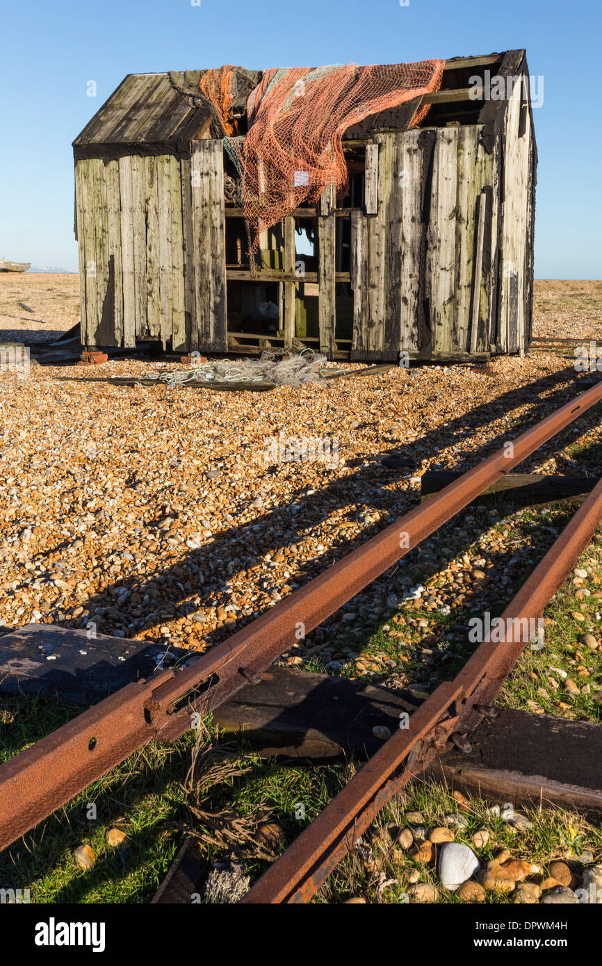 Dilapidated Old Fishing Hut and Net on Dungeness Beach - Stock Image